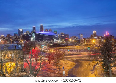 MINNNEAPOLIS, MN - FEBRUARY 2018 - A Wide Angle Twilight Long Exposure of the Minneapolis Skyline Dominated by the Purple US Bank Stadium with Foreground Traffic