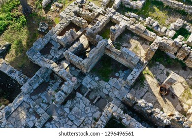 Minoan Archaeological site in Tylissos, Crete Greece form 1600 BC, three houses of rich families, aerial photography details and the whole site