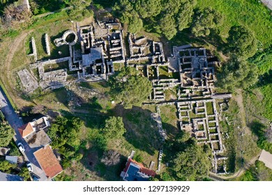 Minoan Archaeological site in Tylissos, Crete Greece form 1600 BC, three houses of rich families, aerial photography details and overview of the whole site
