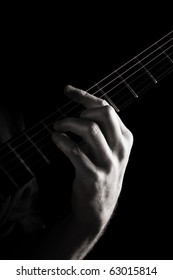 Minor chord (Dm) on electric guitar; toned monochrome image