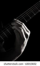 Minor ninth chord (E7b9) on electric guitar; toned monochrome image;