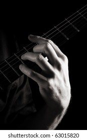 Minor seventh chord (Dm7) on electric guitar; toned monochrome image