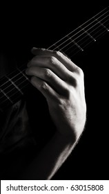 Minor sixth chord (Am6) on electric guitar; toned monochrome image
