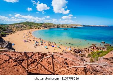 MINORCA, ES - SEPTEMBER 16, 2014: People sunbathing on Cavalleria beach in Minorca, Balearic Islands, Spain.