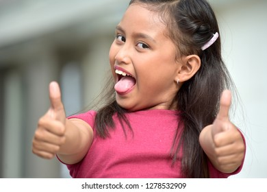 Minority Adolescent With Thumbs Up