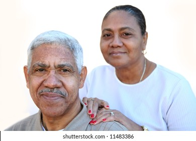 Minority couple set against a white background