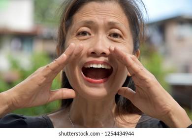 Minority Female Senior Talking