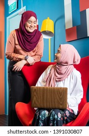 Minority muslim women working in a tech