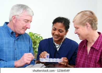 Minority woman giving healthcare to senior at home