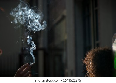Minors smoking in a public venue, discussing the regulation of tobacco and other psychedelic substances. Smokers causing second hand smoking. Concept of unhealthy habits and living. Having discussion