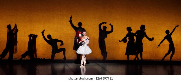 """Minsk - 15 Jun 2018. Ballet """"The Nutcracker, or another Christmas story..."""". Masha (Viktoryia Trenkina) with wooden toy in her hands and mystical shadows. Bolshoi Opera and Ballet Theatre of Belarus"""