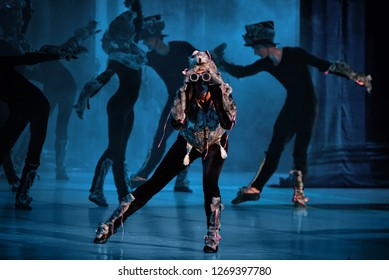 """Minsk - 15 Jun 2018. """"The Nutcracker, or another Christmas story..."""". Hordes of mice fill the room led by Drosselmeier himself in the aspect of the Mouse King frightening Masha (Victoria Trenkina)"""