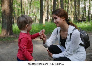 MINSK, BELARUS - 1 OCTOBER, 2020: beautiful mom walks with her little son in the park