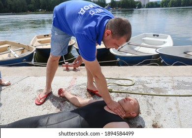 MINSK, BELARUS - 1 OCTOBER, 2020: a rescuer saves a drowning person from the water