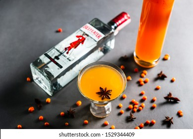 Minsk, Belarus, 10-10-2018. An orange Beefeater gin drink in a cocktail glass with anise and sea-buckthorn liqueur