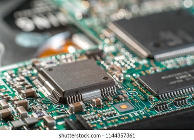 Minsk, Belarus, 2018. Computer chip on green motherboard close up. Computer technology concept