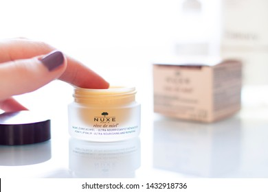 Minsk, Belarus - 22 February 2019. Nuxe reve de miel cosmetic bottle close up. Honey lip balm ultra-nourishing and repairing. French pharmacy product