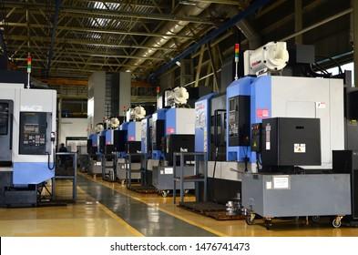 Minsk, Belarus, 27.07.2019: Inside of the Minsk Wheel Tractor Plant VOLAT, MZKT. Workshop of a automotive factory with CNC machine Doosan MYNX 5400/50 VMC vertical machining centre