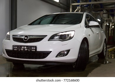 MINSK , BELARUS - 8 DECEMBER : White Opel Astra J at the car service . Opel Astra J  Produced By German Car Manufacturer Opel