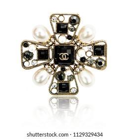 Minsk, Belarus - 8 Jul, 2018: Fashion diamond brooch Chanel isolated on white background. illustrative editorial.