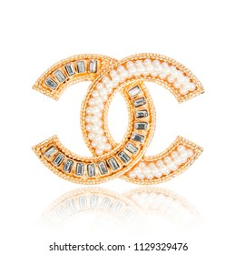 Minsk, Belarus - 8 Jul, 2018: Fashion diamond brooch Chanel isolated on white background. illustrative editorial.