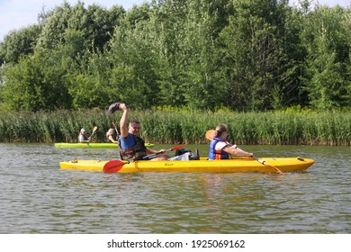 MINSK, BELARUS - 9 AUGUST, 2020: people kayak on the river in the city center in sunny weather