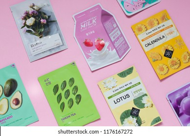 Minsk, Belarus - 9 February 2018: Korean cosmetics flat lay with sheet masks on the pink background. Top view
