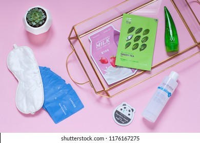 Minsk, Belarus - 9 February 2018: Korean cosmetics flat lay with sheet mask, aloe vera gel on the pink background. Top view