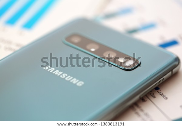 Minsk, Belarus - April 18, 2019: Samsung Galaxy s10 lying at different financial statistics graphs closeup