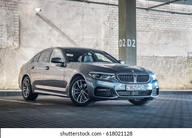 MINSK, BELARUS - APRIL 2, 2017: 2017 BMW 520d in a parking lot. BMW 5 Series has been entirely newly developed allowing for a significant weight loss with the use of aluminum and high-strength steel.