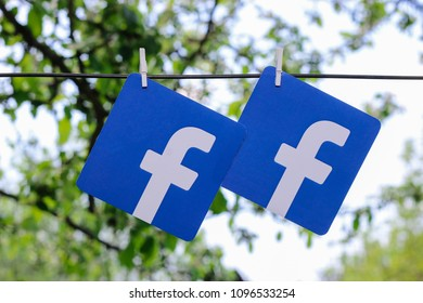 Minsk, Belarus - April, 2018: Printed on paper logos of the famous social network Facebook. Sky and tree are on the background. Concept.