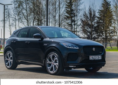 MINSK, BELARUS - April 21, 2018: Jaguar E-Pace parked in front of birch trees. New EPace is Jaguar's first compact SUV. It's a unique combination of looks, agility and dynamic driving.