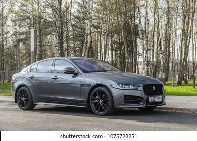 MINSK, BELARUS - APRIL 21, 2018: Grey Jaguar XE sport sedan parked on a parking lot.