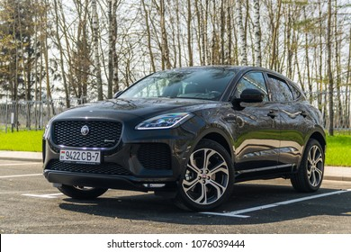 MINSK, BELARUS - April 21, 2018: Absolutely new black Jaguar E-Pace parked on a parking lot. New E?Pace is Jaguar's first compact SUV. Trees in the background.