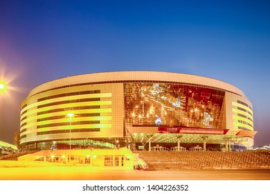 Minsk- Belarus, April 23, 2019: Minsk Arena Complex as the Main Sport Venue with Yellow Night Illumination for Second European Games in April 23, 2019 in Minsk, Belarus