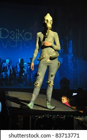 """MINSK, BELARUS. APRIL 23: Festival of fashion """"DZIKA VITA"""". An unidentified young beautiful female showing leather image at the festival of fashion in Minsk, Belarus.  April23, 2009."""