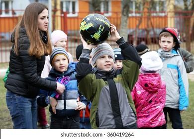 MINSK, BELARUS - APRIL 24, 2015: preschool kids playing outdoors