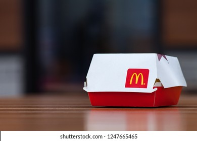 Minsk, Belarus, April 24, 2018: Big Mac Box with McDonald's logo on table in McDonald's Restaurant terrace