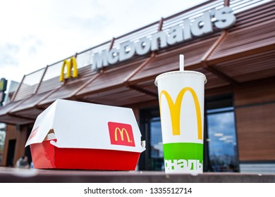 Minsk, Belarus, April 24, 2018: Big Mac and soft drink cup on table in McDonald's restaurant terrace