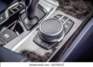 MINSK, BELARUS - APRIL 4, 2017: photo of the iDrive selector of BMW 5 series (G30). The overall interior design was clearly taken from the big brother 7 Series.