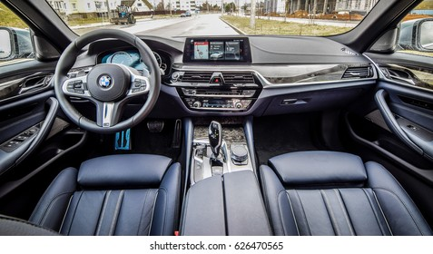 MINSK, BELARUS - APRIL 4, 2017: interior of BMW 5 series (G30). The overall interior design was taken from the 7 Series. It allows 5 Series buyers to get the luxury that the brand's flagship provides.
