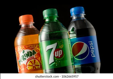 MINSK, BELARUS, APRIL 5, 2018: Plastic  Bottles of Pepsi, Mirinda and 7up isolated on black background. These carbonated soft drink are produced and manufactured by PepsiCo.