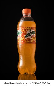 MINSK, BELARUS- APRIL 5, 2018: Mirinda plastic bottle isolated on black background. Mirinda is a carbonated soft drink that is produced and manufactured by PepsiCo.