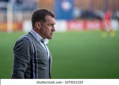 MINSK, BELARUS - APRIL 7, 2018: Sergei Gurenko, head coach of FC Dynamo Minsk react during the Belarusian Premier League football match between FC Dynamo Minsk and FC Isloch at the FC Minsk Stadium.