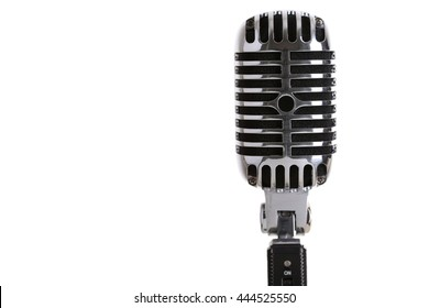 MINSK, BELARUS - AUGUST 1, 2015: Silver old fashioned stage microphone like shure (Elvis microphone). Karaoke, vocal learning, music shop or radio concept. Retro style mic ready to rock