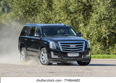 MINSK, BELARUS - AUGUST 1, 2017: Cadillac Escalade simulates evasive maneuver during a test-drive event. This full-size SUV demonstrates good maneuverability and safe handling characteristics.