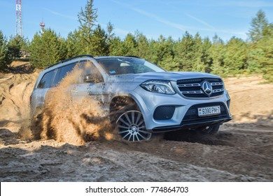 MINSK, BELARUS - AUGUST 1, 2017: Mercedes-Benz GLS 400 4Matic drives off-road in a deep sand quarry. This SUV has an all-wheel drive transmission and has good off-roading capability.