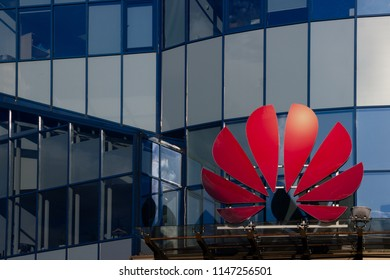 MINSK, BELARUS - August 1, 2018 : Huawei logo at skyscraper in the city center. New modern glass office building of technology mobile China company at Rubin Plaza center.