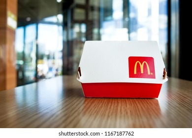 Minsk, Belarus - august 12, 2018: Big Mac Box with McDonald's logo on table in McDonald's Restaurant