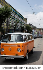 Minsk, Belarus, August 14 2018 - white and Orange Volkswagen Type 2 VW T2 parked on the street, known as the Transporter, Kombi or Microbus, or Bus Camper panel van introduced in 1950 by the German